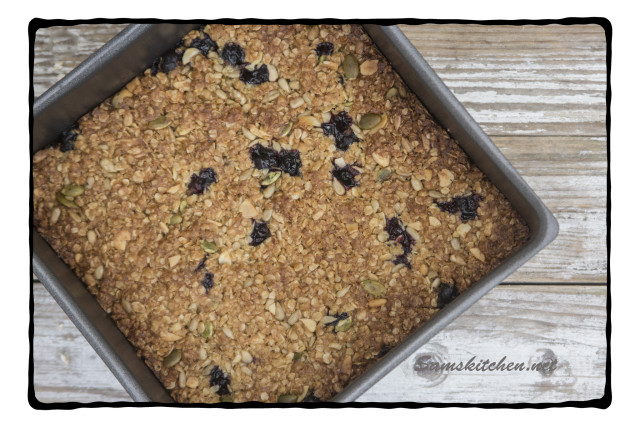 Blackcurrant bars in tin baked